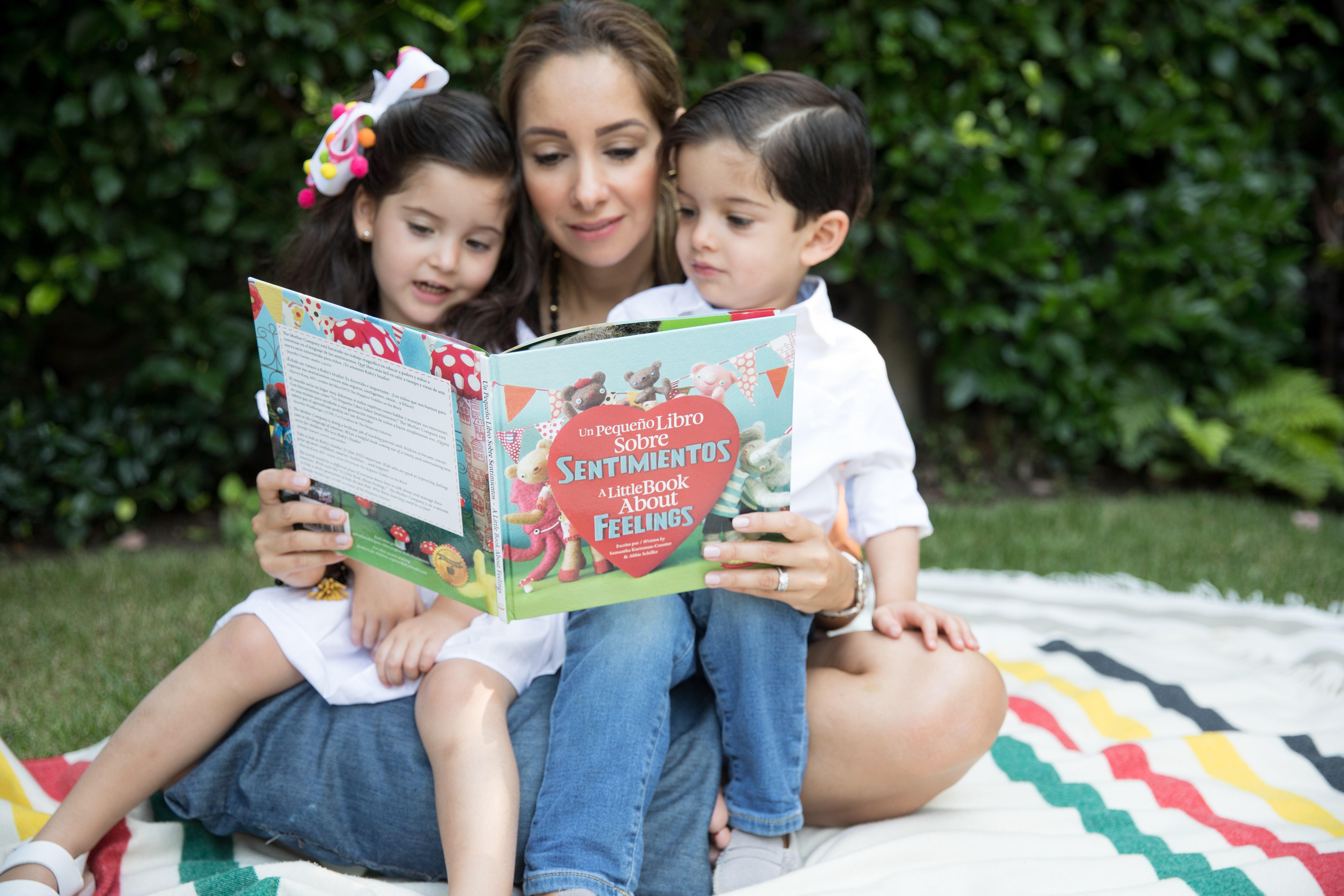 Mom reading Sentimientos to siblings